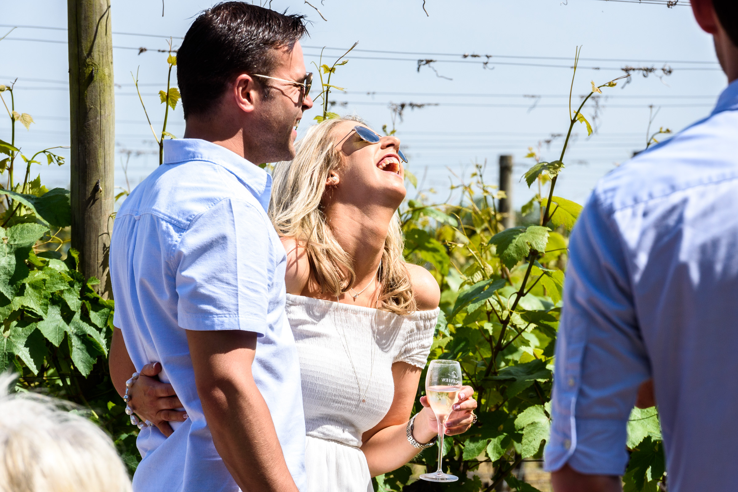 Couple laughing amongst the Vines